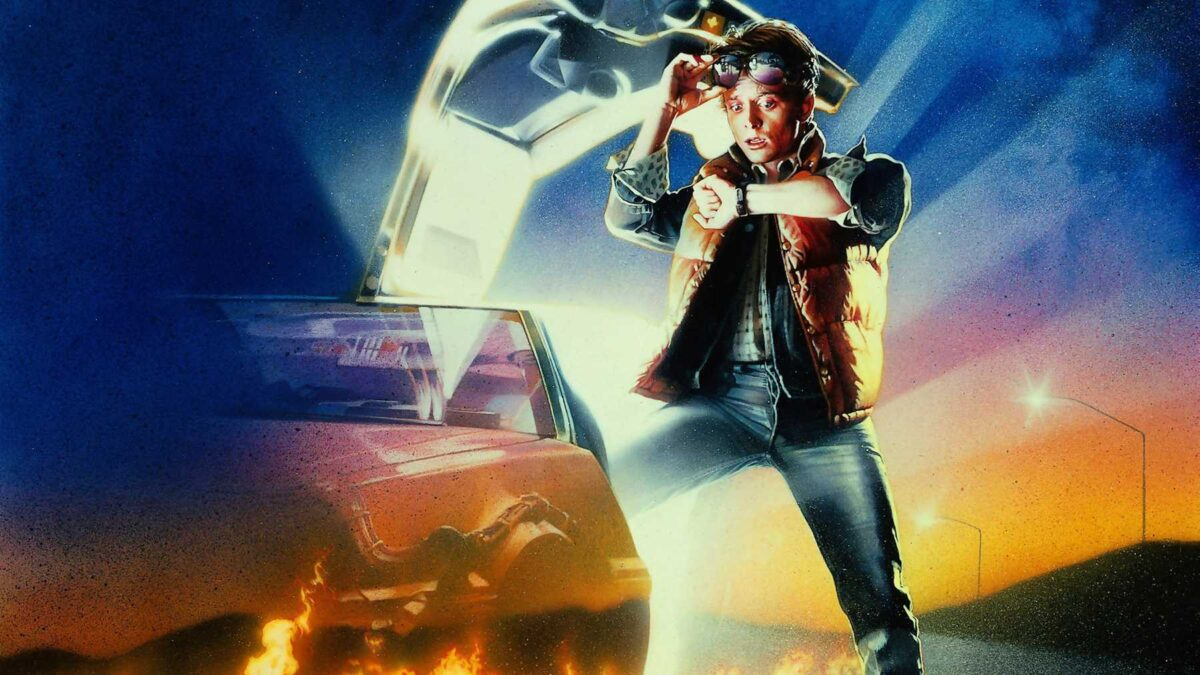 Marty McFly looks at his watch with one leg in the DeLorean time machine as it glows