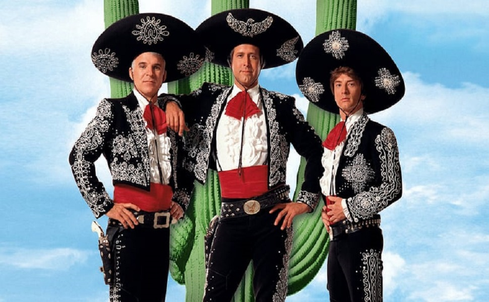 the three amigos standing in front of a cactus